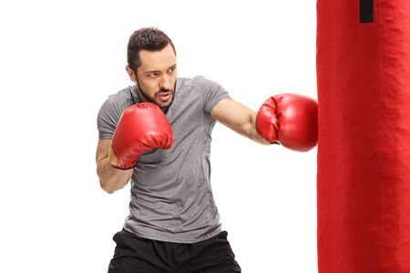 Boxer punching in a red bag isolated on white background