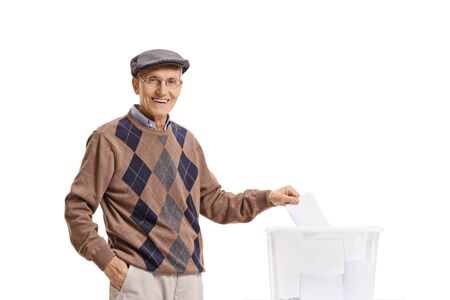 Elderly gentleman voting at the ballot box isolated on white 版權商用圖片