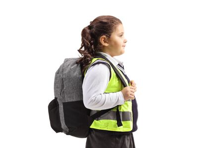 Schoolgirl with a safety vest standing isolated on white background