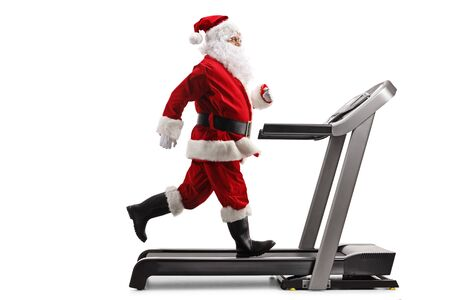 Full length profile shot of Santa Claus running on a treadmill isolated on white background