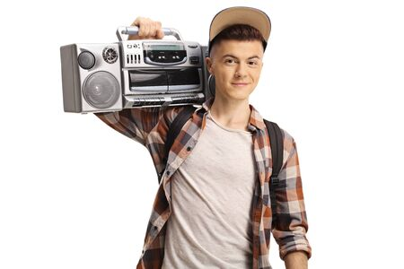 Teenage boy holding a boombox radio isolated on white Stok Fotoğraf