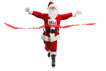 Full length portrait of Santa Claus on the finish line of a race isolated on white background