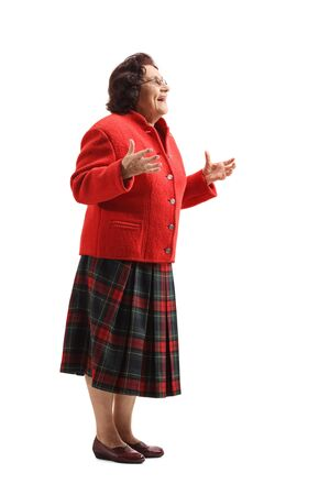 Full length shot of a surprised elderly woman gesturing with hands isolated on white background