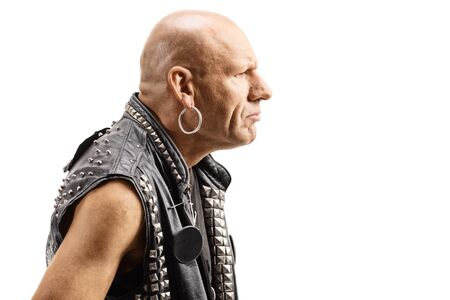 Close up profile of an angry bald man in a leather vest isolated on white background