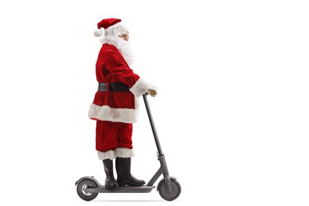 Full length portrait of Santa Claus riding an electric scooter isolated on white background