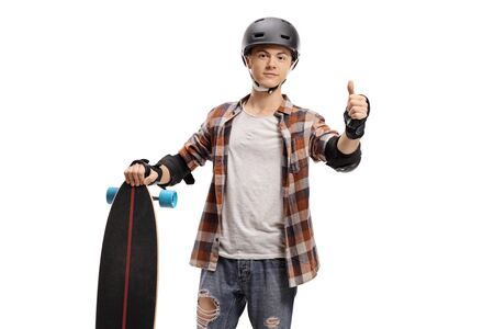 Guy with protective equipment and a longboard making a thumb up gesture isolated on white background 版權商用圖片