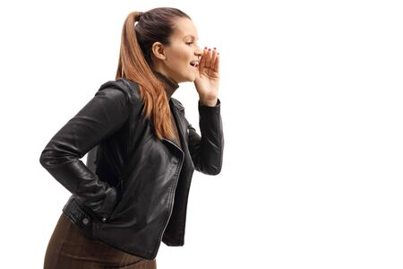 Young woman in a leather jacket whispering isolated on white