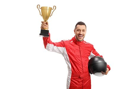 Happy winner racer raising a gold trophy and holding a helmet isolated on white background Stock Photo