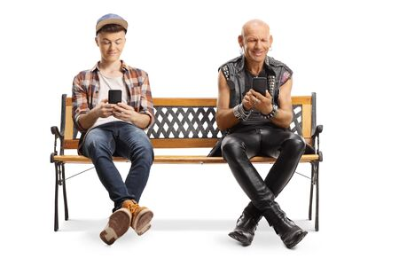 Happy punker and a young guy on a bench using smartphones isolated on white background