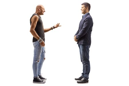 Full length profile shot of a male hipster talking to a young guy isolated on white background
