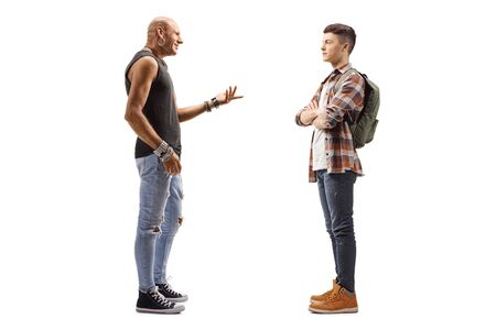 Full length profile shot of a male hipster and a student having a conversation isolated on white background