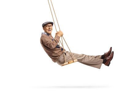 Smiling senior getleman swinging and looking at the camera isolated on white background