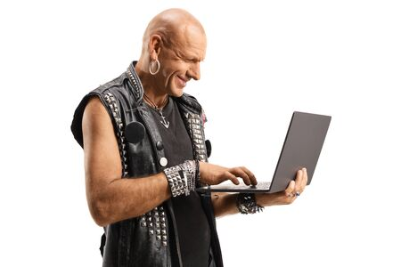 Bald punk using a laptop computer isolated on white background