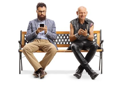 Bearded man and a punker sitting on a bench and typing on mobile phones isolated on white background
