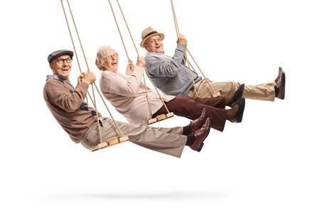 Happy senior people swinging on swings isolated on white background
