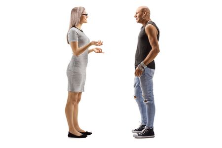 Full length profile shot of a woman talking to a bald male hipster isolated on white Reklamní fotografie