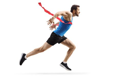 Full length profile shot of a fit man finishing a race isolated on white