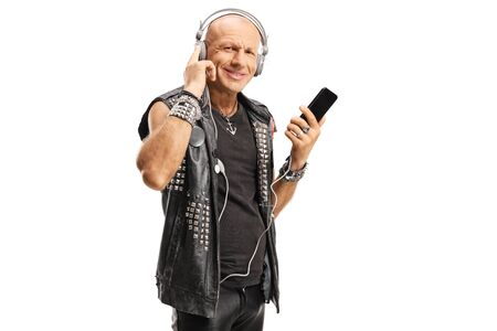 Bald punk wearing leather vest listening to music with headphones isolated on white background