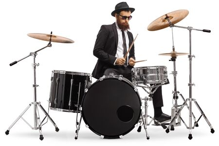 Elegant male drummer playing a drumkit isolated on white background Imagens