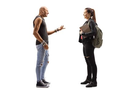 Full length profile shot of a male hipster and a female student talking isolated on white background
