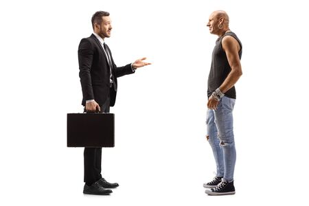 Full length profile shot of businessman talking to a male hipster isolated on white Reklamní fotografie
