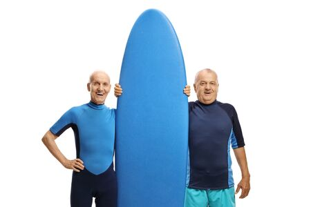 Elderly men with a surfboard isolated on white background
