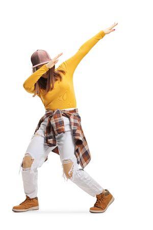 Female trendy teenager dabbing isolated on white Reklamní fotografie