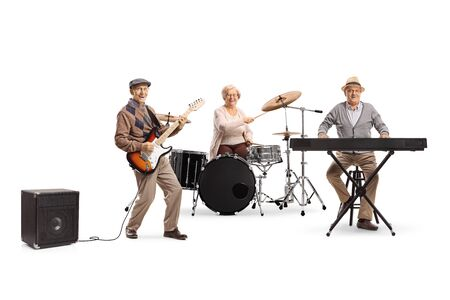 Senior people in a music band playing drums, keyboard and a guitar isolated on white background