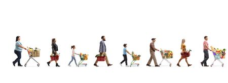 Full length profile shot of people with shopping carts and baskets in a queue bying food isolated on white background Stock Photo
