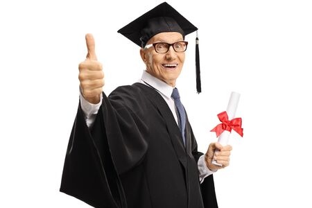 Happy senior man in a graduation gown holding a diploma and showing thumbs up isolated on white background
