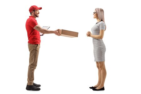 Full length portrait of a delivery guy handing a package to a young woman isolated on white background