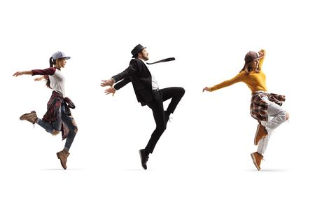 Full length profile shot of two female and one male dancers performing a choreography isolated on white background Banque d'images