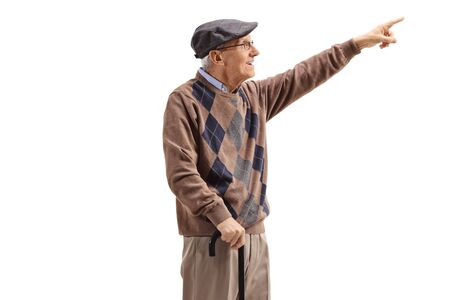 Senior man standing with a cane and pointing up in the distance isolated on white background