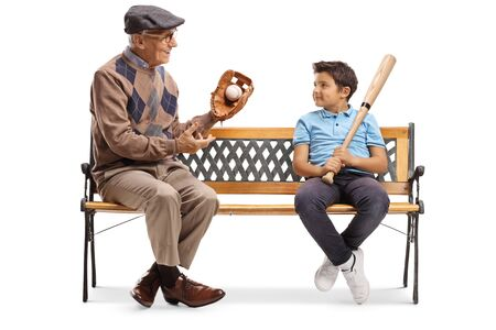 Elderly man with basbeball glove and ball talking to a boy and sitting on a bench isolated on white background