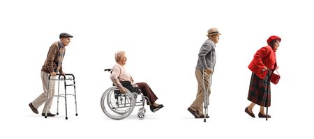 Full length profile shot of a group of senior people walking in a line with orthopedic equipment isolated on white background