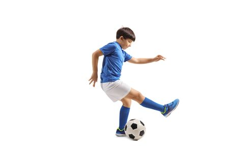 Full length shot of a boy dribbling a soccer ball isolated on white background