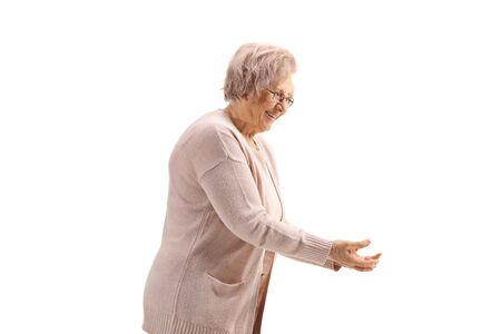 Elderly woman smiling and gesturing with hands isolated on white background