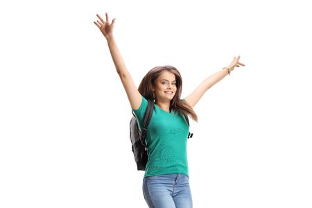 Happy female student with backpack jumping isolated on white background Standard-Bild