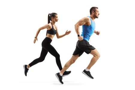 Full length profile shot of fit man and woman in sportswear running isolated on white background