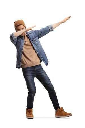 Full length shot of a young guy in casual clothes making a dab pose isolated on white background