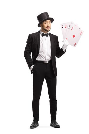 Full length portrait of a magician with big playing cards isolated on white background