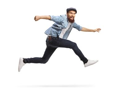Bearded man in casual clothes jumping isolated on white