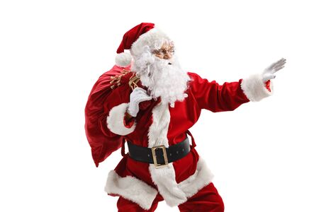 Santa Claus with a sack in a hurry gesturing with hand isolated on white background Stock Photo