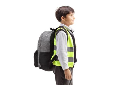 Schoolboy with a safety vest standing isolated on white background