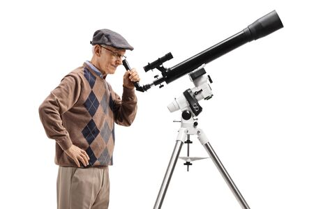 Senior man looking through a telescope isolated on white background