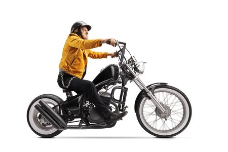 Elderly man in a yellow leather jacket riding a black custom motorbike isolated on white background