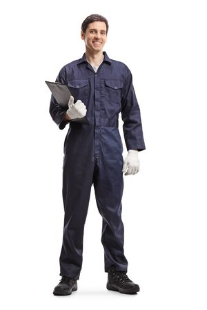 Full length portrait of an auto mechanic holding a clipboard isolated on white background