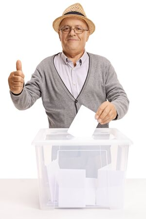 Senior citizen voting and showing thumbs up isolated on white background
