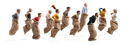 Profile shot of many people playing a gunny race and jumping with sacks isolated on white