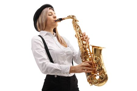 Jeune musicienne jouant du saxophone isolé sur fond blanc Banque d'images